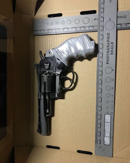 Three men and a woman were arrested and a gun was seized