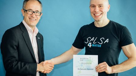 Tim Wainwright, WaterAid chief executive, presenting Samson Kendall with his Points of Light award.