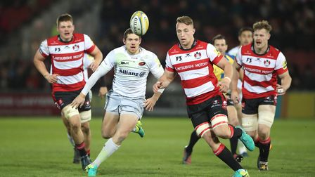 Saracens' Alex Goode gives chase to ball with Gloucester Rugby's Ruan Ackermann during the Aviva Pre