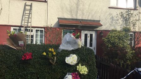 Floral tributes at the scene of the murder in Hill Road, Muswell Hill. Photo: Aine Fox/PA Wire