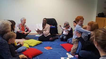 Cllr Anntoinette Bramble reads to children at the programme. Picture: Peabody
