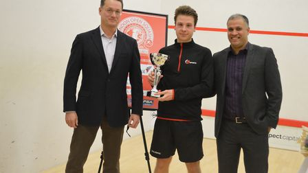 Men's winner Charles Sharpes (centre) with tournament director Zubair Khan (right) and Anthony Todd