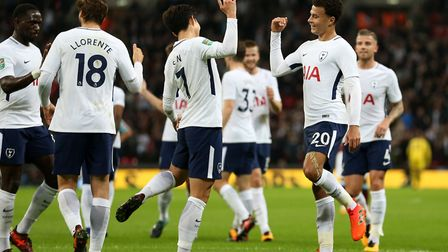 Tottenham Hotspur's Dele Alli (right) celebrates scoring his side's second goal of the game with tea