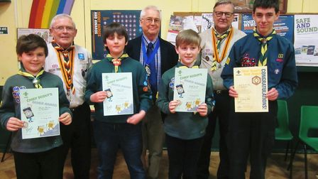Pictured in the back row from left is Peter Jarvis, deputy county commissioner for Suffolk Scouts, M