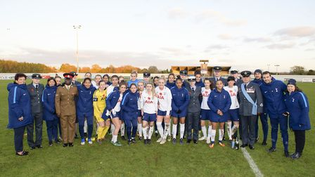 Tottenham Hotspur Ladies stand alongside some members of the Armed Forces (pic: wusphotography.com).