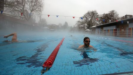 Swimmers in happier, though colder, times brave freezing temperatures for a dip at the London Fields