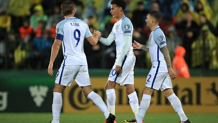 England's Harry Kane (left) celebrates with team-mates Dele Alli (centre) and Kieran Trippier after