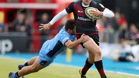 Saracens' Alex Goode is tackled by London Irish's Tom Fowlie (pic: Adam Davy/PA)