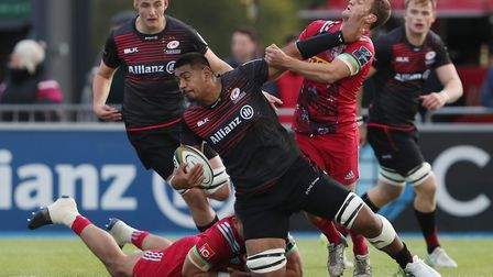 Saracens Will Skelton is tackled by Harlequins Lewis Boyce and Charlie Mulchrone during the Anglo We