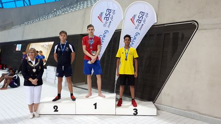 Shakil Giordani on the podium after his bronze medals (pic: Haringey Aquatics).