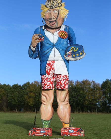 Members of Edenbridge Bonfire Society unveil their celebrity effigy of Boris Johnson ahead of their