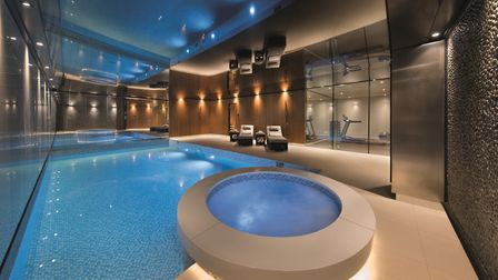 The property's leisure suite features a pool, hot tub, sauna, gym and bar.