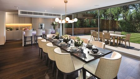 A dining room looks out across the perfectly maintained gardens.