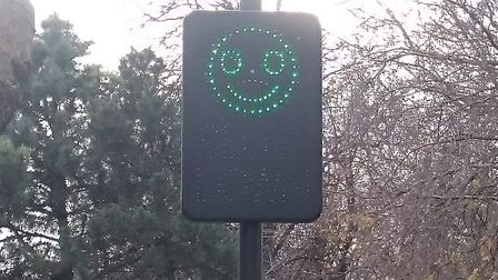 Sinister: The smiley face displayed if cyclists ride below 12mph. Picture: Madeleine Saghir