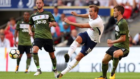 Tottenham Hotspur's Harry Kane gets in a shot against Juventus during their pre-season friendly at W