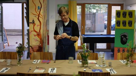 Daniel setting up tables for the Headway Eats supper clubs held at the charity's Day Centre in Hagge