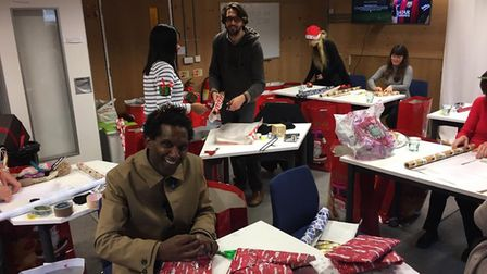 Lemn Sissay wrapping presents for the Christmas Dinner last year