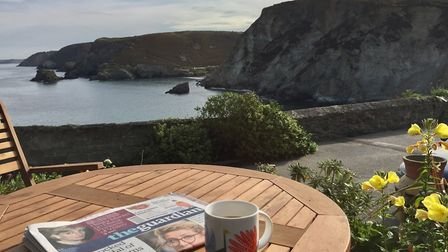 Enjoying the Saturday papers and a cup of coffee outside Pier Cot. Picture: Emma Bartholomew