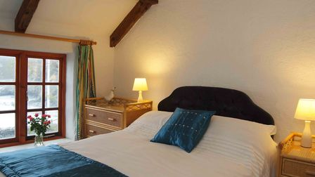 One of the three bedrooms in Sea View. Picture: Cove Cottages
