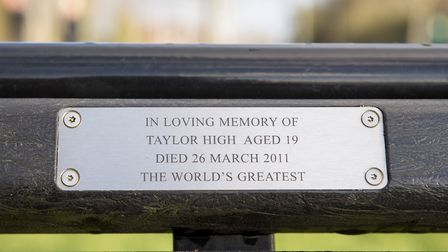 Elaine, Gary and Curtis High with his son Olly at the memorial bench to son and brother Taylor who d