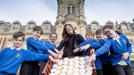 Youngsters from Somerleyton Primary School enjoy the Penny and Bun Day with Lady Somerleyton. Pictur