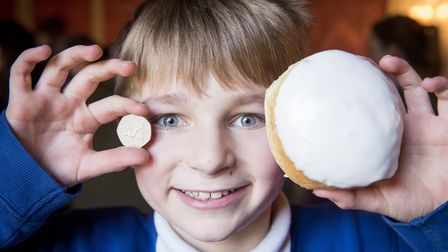 Somerleyton Primary School year six pupil Harry with his 50p and sticky bun at Somerleyton Hall. Pic