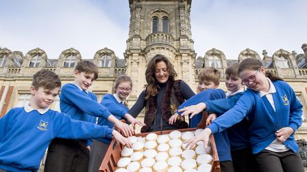 Youngsters from Somerleyton Primary school enjoy the penny bun day with Lady Somerleyton.Picture: Ni