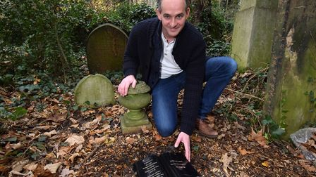 Pc Clifford Fox with the new memorial for Pc Lillicrap at Abney Park Cemetery. Picture: Polly Hancoc