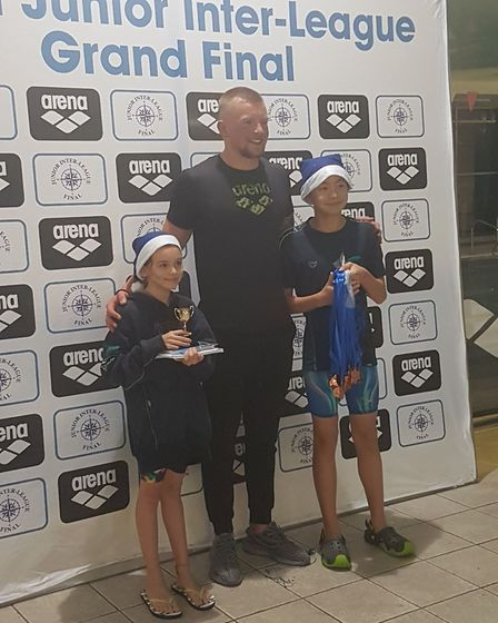 Camden Swiss Cottage captains Ines Guimond Beetham and Leo He with Olympic champion Adam Peaty at th
