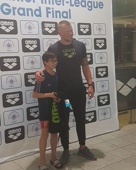 Camden Swiss Cottage's Nicholas Finch receives his best 11-year-old boy trophy at the Arena Junior I