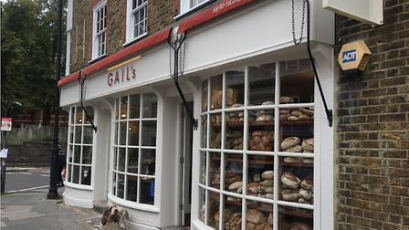 Thieves on moped used hammers to smash window of Gails bakery and rob customers in an attack earlier