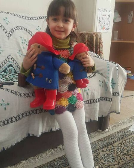 Nazanin and Richard's three-year-old daughter Gabriella wearing a 'freedom pinafore' her mother made