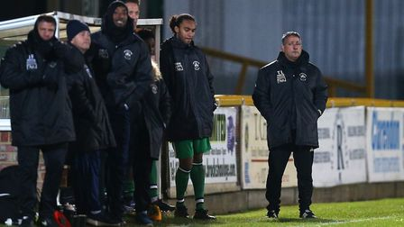 Haringey manager Tom Loizou (right) looks on during Romford vs Haringey Borough in the Bostik North