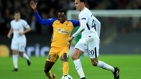 Tottenham Hotspur's Dele Alli (right) looks to keep the ball away from APOEL's Franco Vinicius durin