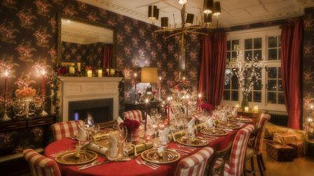 The dining room dressed for Christmas.