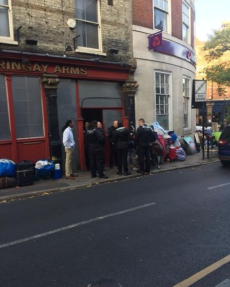 Enforcement officers outside the Harringay Arms on October 17. Picture: LUKE CAWLEY-HARRISON