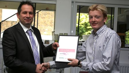 Jacob Ranson receiving his award from Group Editor Michael Adkins after completing the Barking and D