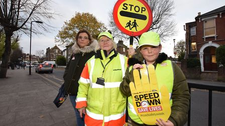 Parent Zoe Clarkson, lollipop lady Ros Littlejohn and Maisy Clarkson, nine, who is the junior road s