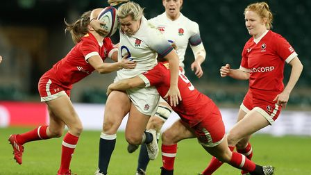 England's Marlie Packer is tackled by Canada's Anais Holly and Justine Pelletier during the Autumn I