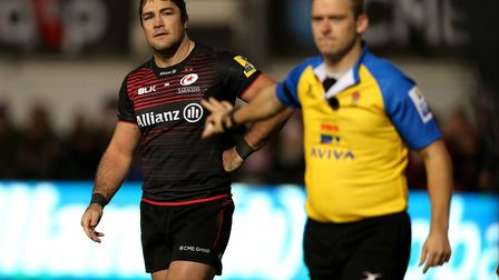Saracens' Brad Barritt tries to talk to referee Ian Tempest as he watches a replay during the Aviva