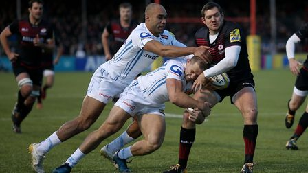 Saracens' Alex Goode and Exeter's Sam Hill and Olly Woodburn in action at the Allianz Arena (pic Pau