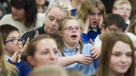 Pupils at the Warren School in Lowestoft take part in the Sign2sing event along with special guests