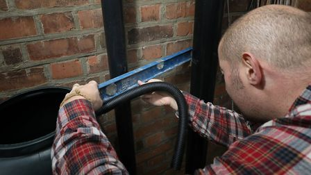 If you're choosing which downpipe to connect to, use one that gets its rain from a large portion of