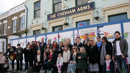 Campaigners rejoice after learning the Chesham Arms would be saved. Picture: Isabel Infantes