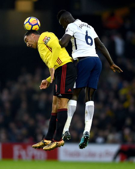 Watford's Troy Deeney (left) and Tottenham Hotspur's Davinson Sanchez battle for the ball at Vicarag