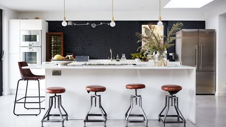 Lucy St George's kitchen, with its polished concrete floor and modern units,which is designed for ma