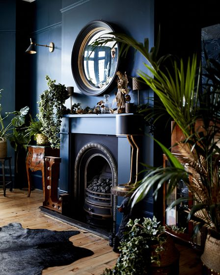 Lucy St George's lounge where dark walls are a perfect backdrop for rich, mellow tones of dark wood