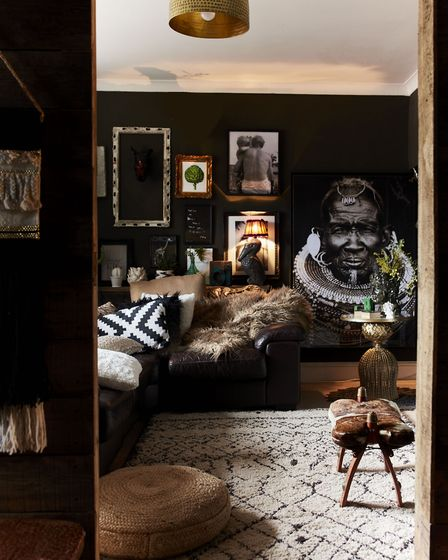 A dark painted wall helps to make all the pieces on display - unusual ethnic treasures including an