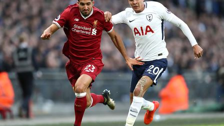Liverpool's Emre Can (left) and Tottenham Hotspur's Dele Alli battle for the ball during the Premier