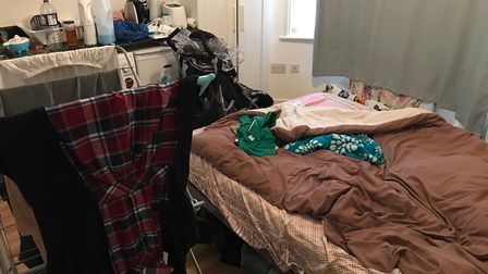 The family's cramped hostel room.